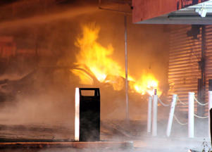 A vehicle crashed into a group of shops in South Auckland rupturing a gas main and setting fire to the car and shops.
