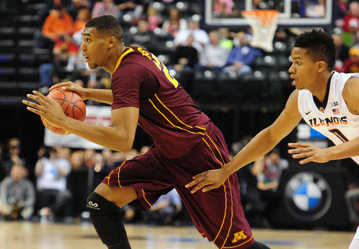 Mar 9, 2016; Indianapolis, IN, USA; Minnesota Golden Gophers center Reggie Lynch (22) drives past Illinois Fighting Illini guard D.J. Williams (0) during the Big Ten Conference tournament at Bankers Life Fieldhouse.