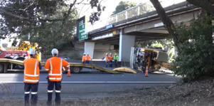 Crews work to clear the aftermath of a crash on the Southern Motorway.
