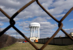 FILE - This March 21, 2016 file photo shows the Flint Water Plant water tower in Flint, Mich.