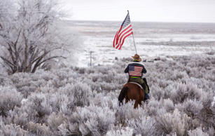 Duane Ehmer rides his horse Hellboy at the occupied Malheur National Wildlife Re...
