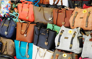 One of the world's most faked brands, Michael Kors recently pulled out of the International Anti-Counterfeiting Coalition because Chinese e-commerce giant Alibaba had been given permission to join the Group. Alibaba is notorious for listing counterfeit products (image shows faux Michael Kors bags on sale at a market in China).
