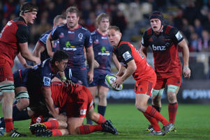 Andy Ellis of the Crusaders looks to pass the ball during the round 11 Super Rugby match between the Crusaders and the Reds at AMI Stadium on May 6, 2016 in Christchurch, New Zealand
