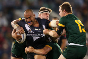 Sam Moa of the Kiwis is tackled by Michael Morgon of the Kangaroos during the International Rugby League Trans Tasman Test match between the Australian Kangaroos and the New Zealand Kiwis at Hunter Stadium on May 6, 2016 in Newcastle, Australia