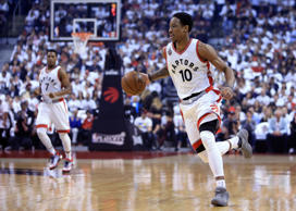 DeMar DeRozan #10 of the Toronto Raptors dribbles the ball in the first half of Game Five of the Eastern Conference Semifinals against the Miami Heat during the 2016 NBA Playoffs.