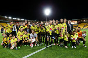 Phoenix players pose for a team photo as they farewell Ben Sigmund and Manny Muscat during the round 27 A-League match between the Wellington Phoenix and Western Sydney Wanderers at Westpac Stadium on April 10, 2016 in Wellington, New Zealand