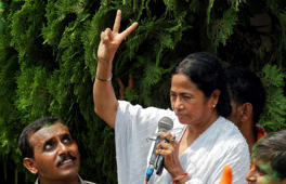 File: Trinamool Congress party leader Mamata Banerjee flashes the v for victory sign outside her home in Kolkata, May 13, 2011.
