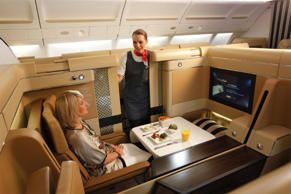 According to an anonymous hostess, she is allowed to offer upgrades to first or business class once the doors of the plane are closed. She adds that it is not done often, mainly because most airlines ask for a report explaining why a passenger was moved, though also because they must have an extra meal prepared or sometimes because the front cabins are already full.