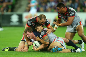 Tim Glasby of the Storm is tackled during the round eight NRL match between the Melbourne Storm and the New Zealand Warriors at AAMI Park on April 25, 2016 in Melbourne, Australia