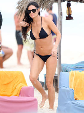 We're not sure how she does it, but Demi Moore's hot bikini body gives her adult daughters' physiques a run for their money!