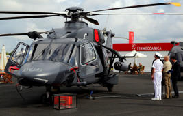 File: Visitors look at an AW149 military helicopter, produced by AgustaWestland, a unit of Finmeccanica SpA, as it stands on display on the second day of the Farnborough International Airshow in Farnborough, U.K., on Tuesday, July 15, 2014.