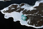 A turquoise lake (C) forms from melting snow near Cape Folger