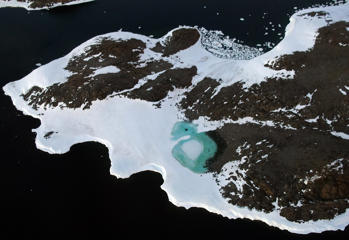 In this file photo, a turquoise lake (C) forms from melting snow near Cape Folger on the Budd Coast on January 11, 2008 in the Australian Antarctic Territory.