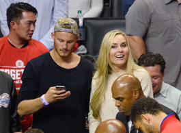 Lindsey Vonn (R) and Alexander Ludwig attend a basketball game between the Portl...