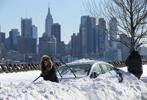 Residents attempt to dig their cars out the snow in New York City, NY on January 24, 2016, after the winter storm Jonas hit New York and Washington.