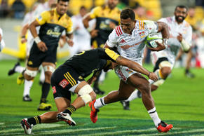 Seta Tamanivalu of the Chiefs is tackled by Matt Proctor of the Hurricanes during the round nine Super Rugby match between the Hurricanes and the Chiefs at Westpac Stadium on April 23, 2016 in Wellington, New Zealand