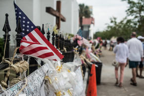 People walk past Emanuel AME Church JULY 31, 2015 in Charleston, South Carolina. Earlier in the morning, Dylann Roof, the shooter in the June 17 massacre was arraigned on 33 federal charges, including hate crimes.