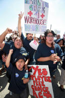 Temp workers and their supporters rally outside a Wal-Mart distribution center i...