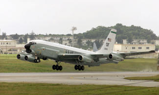 A plane reportedly did a barrel roll over a U.S. reconnaissance plane in interna...