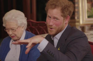 "This image taken from a video released by Kensington Palace, London, on Friday April 29, 2016 shows Queen Elizabeth II sitting with her grandson, Prince Harry as he says ""Boom"" whilst receiving a video call from the President of the United States, Barack Obama and Michelle Obama."