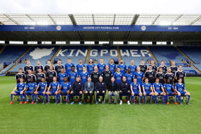 LEICESTER, ENGLAND - OCTOBER 23: Back Row: Callum Smithson (Technical Scout Intern), Mitchell Willis (First Team Strength & Power Coach), Ben Wrigglesworth (Head of Technical Scouting), Jon Sanders (Player Liaison Officer), Jacob Blyth, Christian Fuchs, Yohan Benalouane, Robert Huth, Leonardo Ulloa, Marcin Wasilewski, Gokhan Inler, Simon Murphy (Assistant First Team Physio), Gary Silk (First Team Masseur), Andy Blake (Senior First Team Performance Analyst), Paul Balsom (Sports Science Consultant). Middle Row: Tom Joel (First Team Sports Scientist), Paul McAndrew (Kit Man), Dave Rennie (Head Physio), Mike Stowell (First Team Coach), Danny Simpson, Joe Dodoo, Andy King, Kasper Schmeichel, Mark Schwarzer, Matty James, Jeffrey Schlupp, Ritchie De Laet, Pete Clark (First Team Performance Analyst), Matt Reeves (Head of Fitness & Conditioning), Andrea Azzalin (First Team Sports Scientist & Conditioning Coach), Ollie Waldron (Technical Scout). Front Row: Andrej Kramaric, N'Golo Kanté, Riyad Mahrez, Danny Drinkwater, Wes Morgan, Craig Shakespeare (Assistant Manager), Vichai Srivaddhanaprabha (Chairman), Claudio Ranieri (Manager), Aiyawatt Srivaddhanaprabha (Vice Chairman), Paolo Benetti (Assistant Manager), Jamie Vardy, Marc Albrighton, Shinji Okazaki, Nathan Dyer, Ben Chilwell during the Leicester City photo call at King Power Stadium on October 23, 2015 in Leicester, United Kingdom. (Photo by Plumb Images/Leicester City FC via Getty Images)