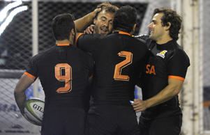 Jaguares' centre Juan Martin Hernandez (2nd-L) celebrates with teammates after scoring the team's first try during their Super Rugby match against Southern Kings at the Jose Amalfitani stadium.