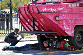 Investigators work the scene of an accident involving a Duck Boat on Saturday, April 30, 2016 in Boston.