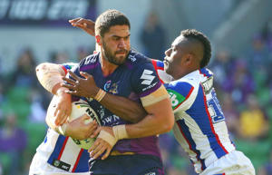 Jesse Bromwich of the Storm is tackled during the round five NRL match between the Melbourne Storm and the Newcastle Knights at AAMI Park on April 2, 2016 in Melbourne, Australia