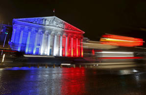 File: The National Assembly is lit with the blue, white and red colours of the French flag in Paris, France, November 19, 2015, to pay tribute to the victims of a series of deadly attacks that occurred last Friday in the French capital.