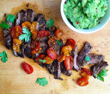 "<p>The best kind of side? Guac.</p><p>Get the recipe from <a href=""http://www.delish.com/cooking/recipe-ideas/recipes/a43494/grilled-skirt-steak-with-blistered-tomatoes-guacamole-recipe/"">Delish</a>.<br></p>"