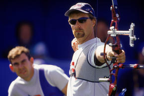 SYDNEY, AUSTRALIA - SEPTEMBER 22: Butch Johnson of the United States releases an arrow as Victor Wunderle looks on during the Olympic Men's Archery competition at the Sydney International Archery Park in Sydney, Australia on September 22, 2000. (Photo by Darren McNamara/Getty Images)