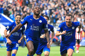File photo dated 03-04-2016 of Leicester City's Wes Morgan (centre) celebrates scoring their first goal of the game.