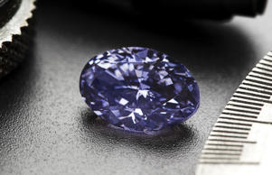 Mining giant Rio Tinto has unveiled a 2.83 carat oval shaped diamond, its largest violet diamond from its Argyle mine in Western Australia.