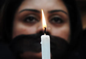 File: Indian members of a social organisation Our City Our Right holds a candle ...