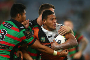 Tim Simona of the Tigers is tackled during the round nine NRL match between the South Sydney Rabbitohs and the Wests Tigers at ANZ Stadium on April 28, 2016 in Sydney, Australia
