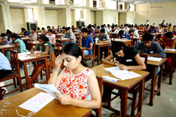 File: Post-graduation institute of medical science conducted the entrance exams for MBBS courses in PGI campus on July 1, 2012 in Rohtak, India. Students while taking exams at a exam centre.
