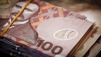 New Zealand dollar declined amid speculation the US dollar