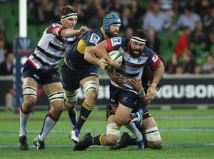Jamie Hagan of the Rebels is challenged by his opponent during the round 12 Super Rugby match between the Rebels and the Brumbies at AAMI Park on May 13, 2016 in Melbourne, Australia