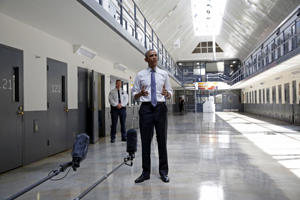 U.S. President Barack Obama speaks to reporters during his visit to the El Reno Federal Correctional Institution outside Oklahoma City on July 16, 2015. Obama is the first sitting president to visit a federal prison; though his election marked a historically significant moment for racial progress, as he ends his second term in office he leaves behind a number of issues of racial equality—police-involved shootings of predominantly unarmed black men among them—that remain unresolved.