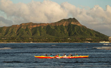 A outrigger canoe paddles past Diamond Head mountain, Wed. Sept. 16, 2015 in Honolulu.