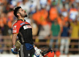 File: Royal Challengers Bangalore captain Virat Kohli celebrates after scoring a century (100 runs) during the 2016 Indian Premier League (IPL) Twenty20 cricket match between Gujarat Lions and Royal Challengers Bangalore at The Saurashtra Cricket Association Stadium in Rajkot on April 24, 2016.