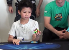 Seven-year-old solves Rubik's Cube in 27 seconds with one hand