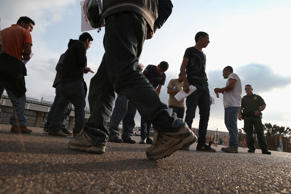 Undocumented immigrants await deportation by Border Patrol agents at the U.S.-Me...