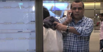 Caught: Paresh Rawal punched his fan at airport