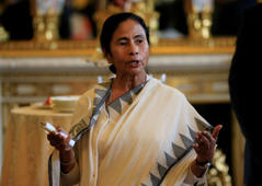 File: West Bengal Chief Minister Mamata Banerjee speaks to guests at a tea for those responsible for assisting with the charity Key to Freedom at Buckingham Palace, London.