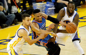 Oklahoma City Thunder guard Russell Westbrook (0) loses control of the ball as Golden State Warriors guard Stephen Curry (30) and forward Draymond Green (23) defend in the third quarter in game five of the Western conference finals of the NBA Playoffs at Oracle Arena. The Warriors won 120-111.