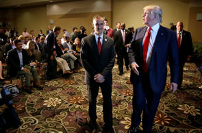 In this Aug. 25, 2015, file photo, Republican presidential candidate Donald Trump, right, walks with his campaign manager Corey Lewandowski after speaking at a news conference in Dubuque, Iowa.