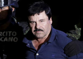 "Recaptured drug lord Joaquin ""El Chapo"" Guzman is escorted by soldiers at the hangar belonging to the office of the Attorney General in Mexico City, Mexico January 8, 2016."