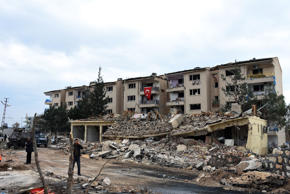 Traffic police station and lodgings are seen in ruins after Kurdish rebels detonated a car bomb in Nusaybin in southeastern Turkey, Friday, March 4, 2016.
