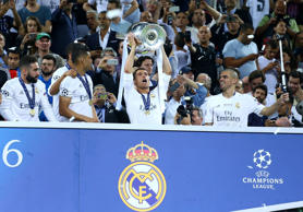 Real Madrid v Atletico Madrid, UEFA Champions League Final, Football, San Siro Stadium, Milan, Italy - 28 May 2016 Cristiano Ronaldo (R) celebrating the victory with the trophy during the Champions League Final Real Madrid vs Atletico Madrid at the San S